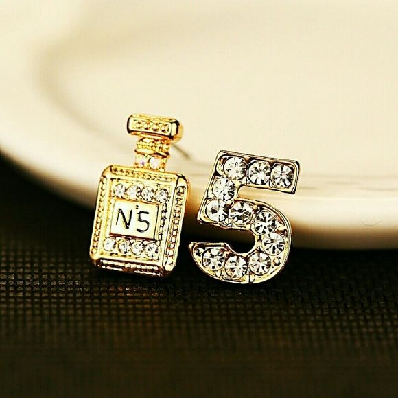 94d9addb24c7 One earring is classic Chanel perfume shape, the other is number 5. For all  Chanel fan out there. Brand ...