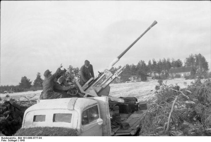 German 50 Mm Anti Tank Gun: A 3.7 Cm FlaK 43 Anti-aircraft Gun Mounted On The Back Of