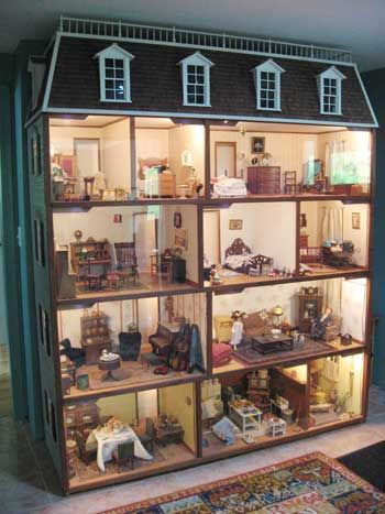 Edwardian dollhouse takes up an entire wall in owner's living room.