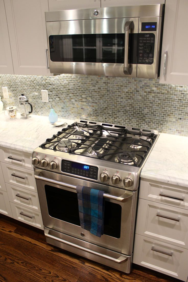 - Slide In Range With Full Backsplash And Stainless Microwave. Gas