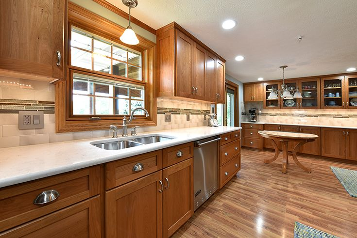 Traditional Kitchen With Natural Cherry Cabinets Quartz