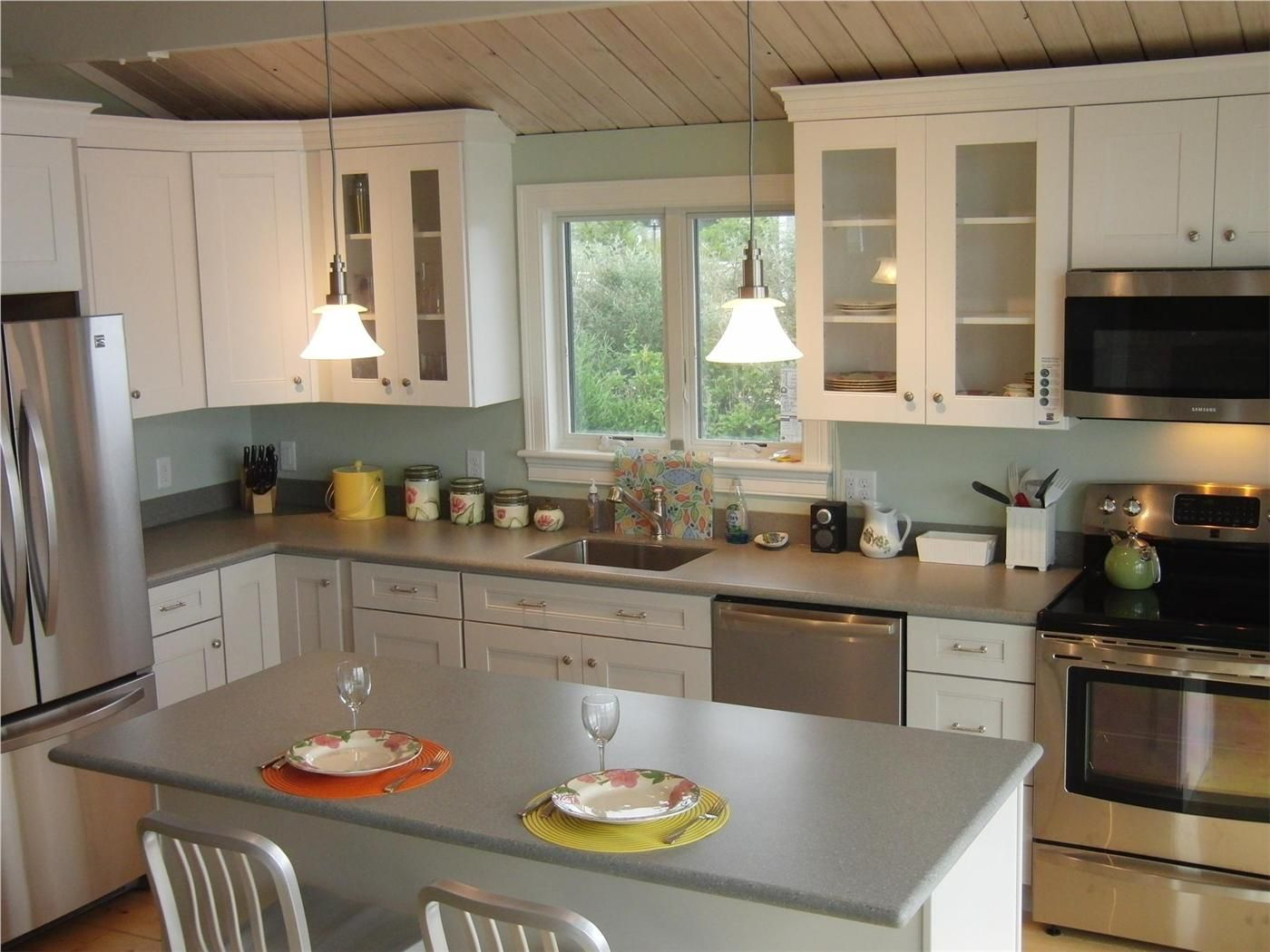 The Chef's Kitchen Features Hardwood Cabinets & Corian ...