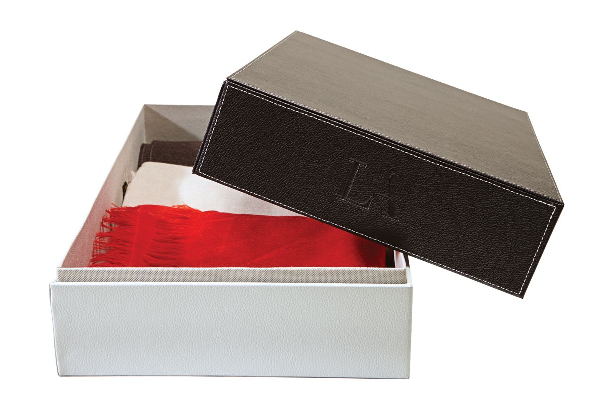 Storage box by Lisa Adams. A new design in storage boxes, this chic color-block leather box will hold a range of treasured belongings, such as sweaters and boots. For more details, go to laclosetdesign.com. #LuxeHoliday