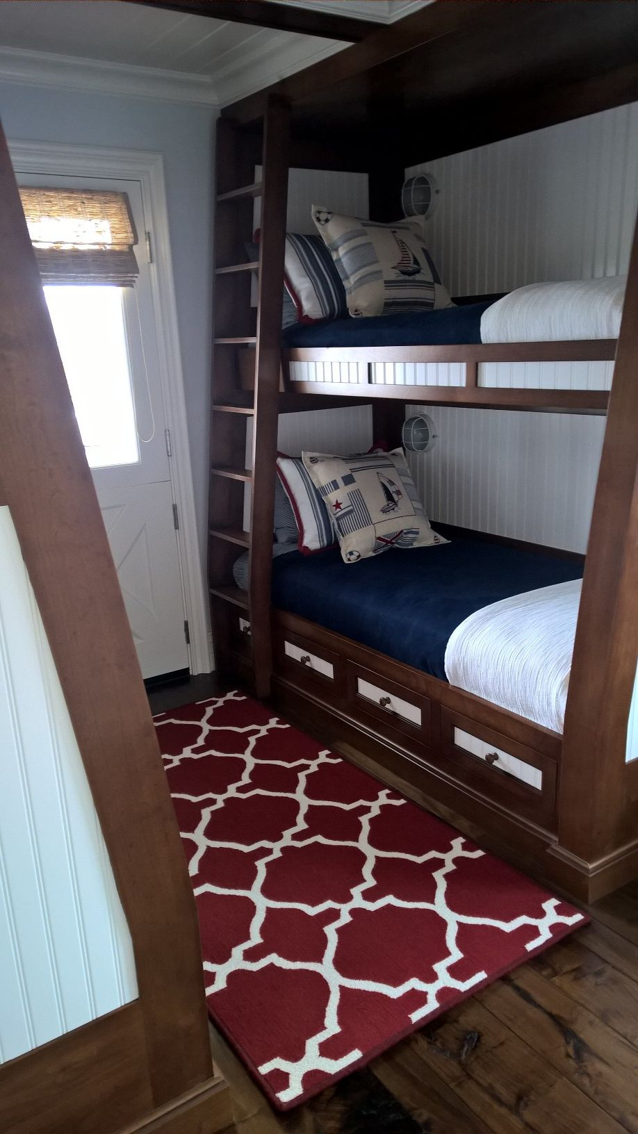 Great looking nautical bedroom featuring fabulous bunk