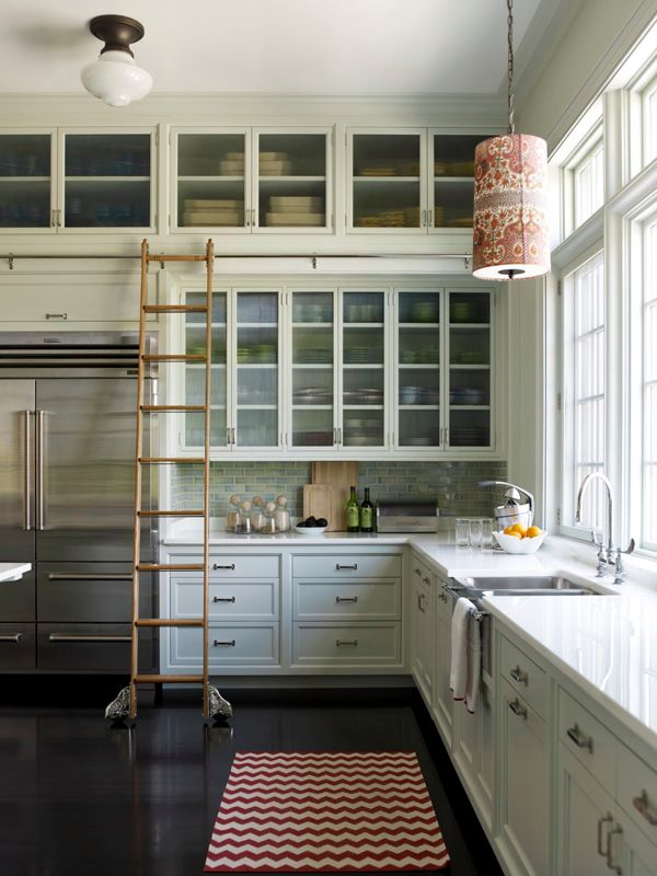 cabinets, all the way to the top+ladder.+ window wall above sink+fridge  (brilliant...and I want it)