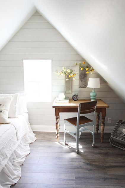 Farmhouse attic guest bedroom by Magnolia Homes - Love the desk.