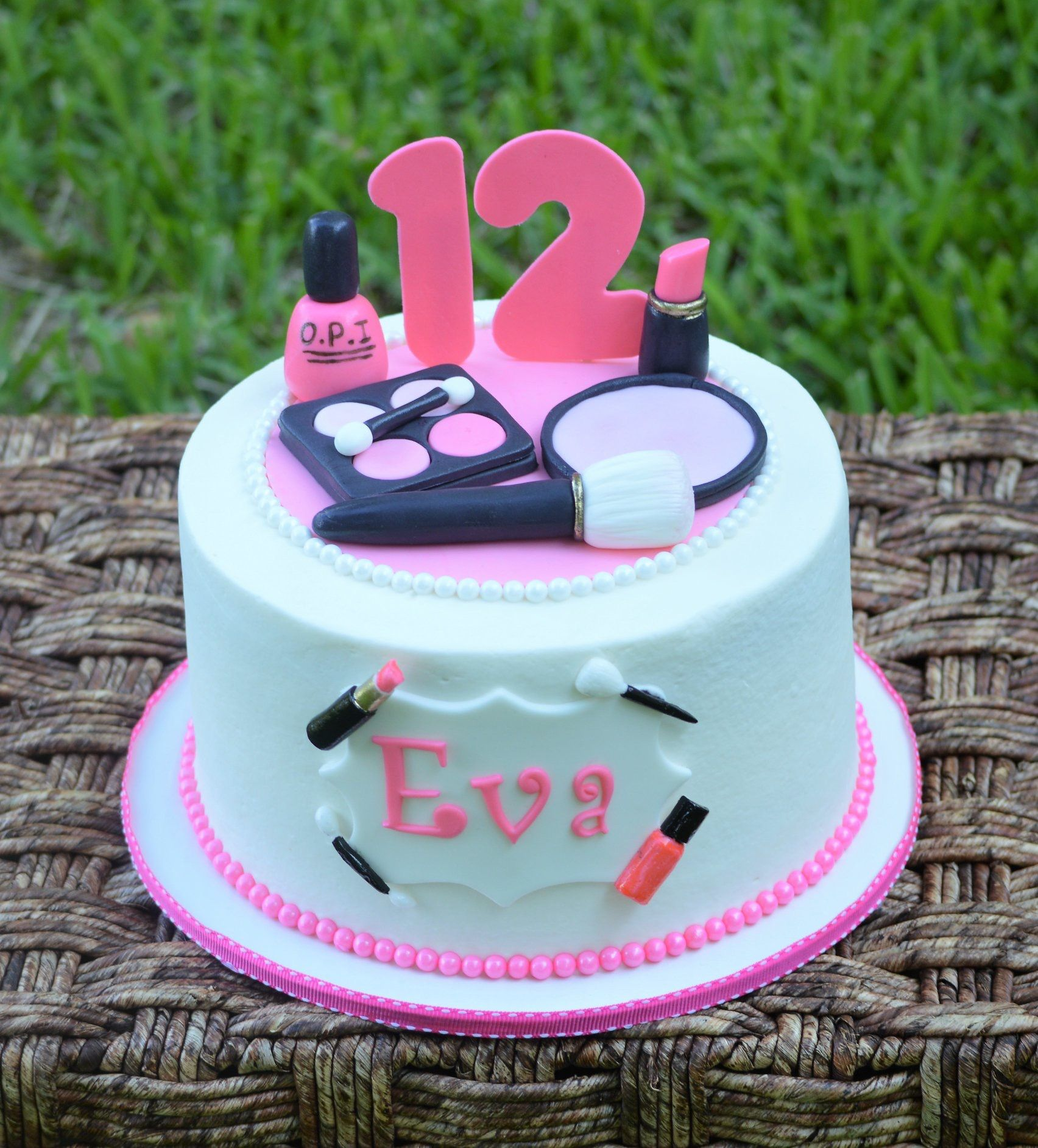 Pink makeup cake made by Little Lady Cakery. White almond