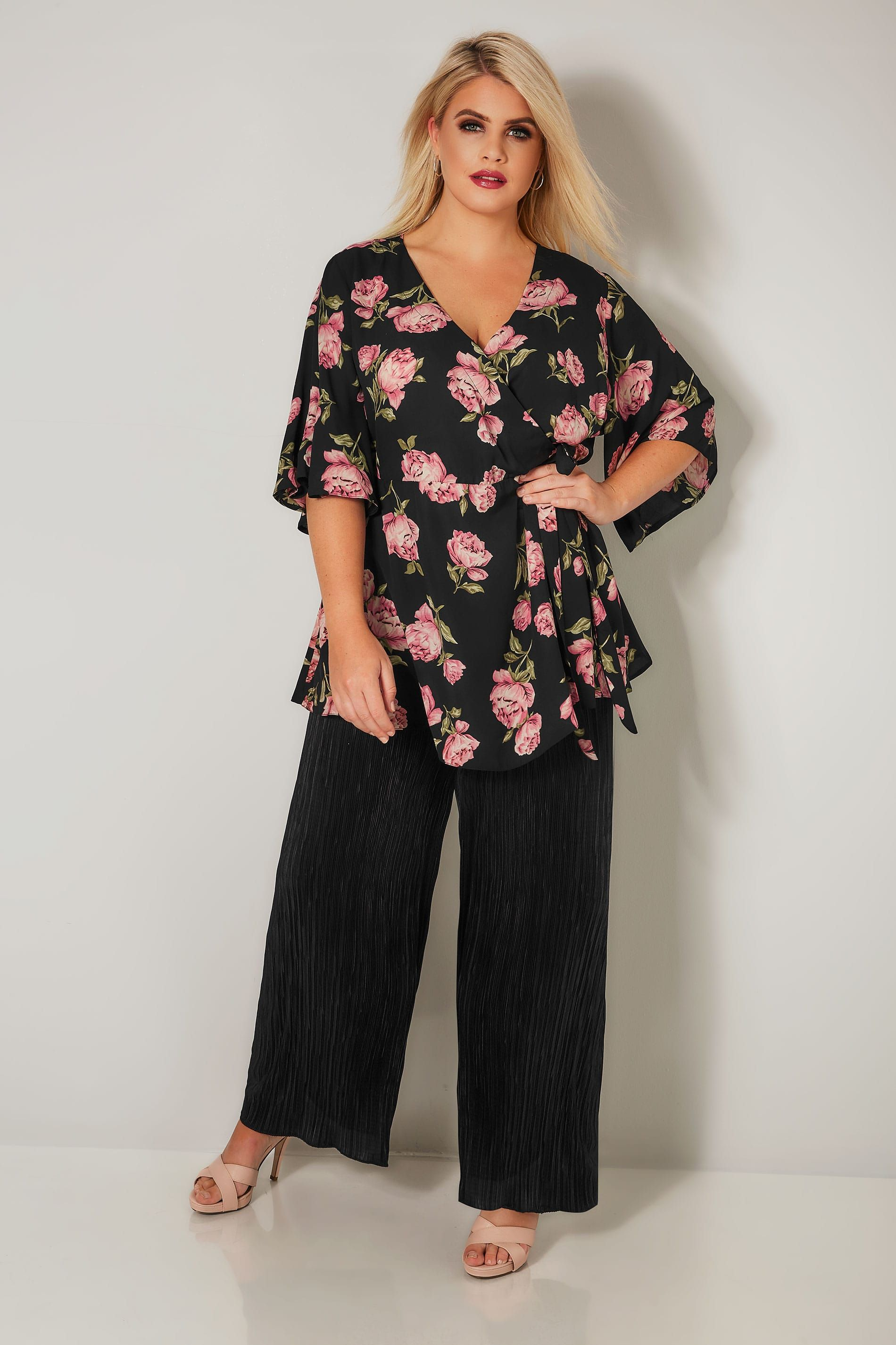6baec4b4fb631 Give your look a fashion update with this pretty peony print blouse.  Featuring a flattering