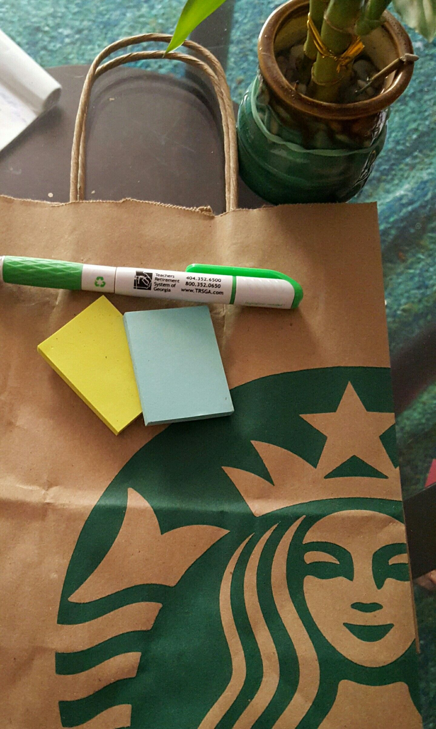 Lime Green Post it notes. Georgia Teacher Retirement Pen. Bamboo Plant. Starbucks Recyclable Bag. 5 Star Crown.