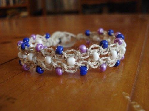 Hemp macrame cuff bracelet with purple blue and white glass beads