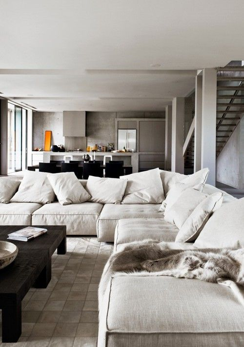 White Kitchen Open To Family Room open concept loft, kitchen open on the living room. big white sofa