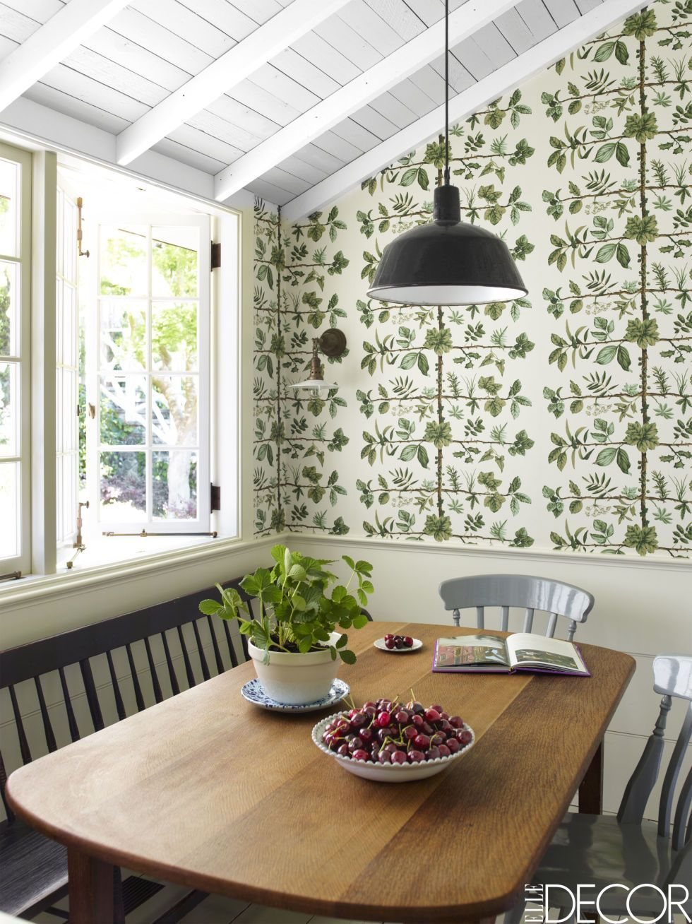 Green floral wallpaper in a dining nook.