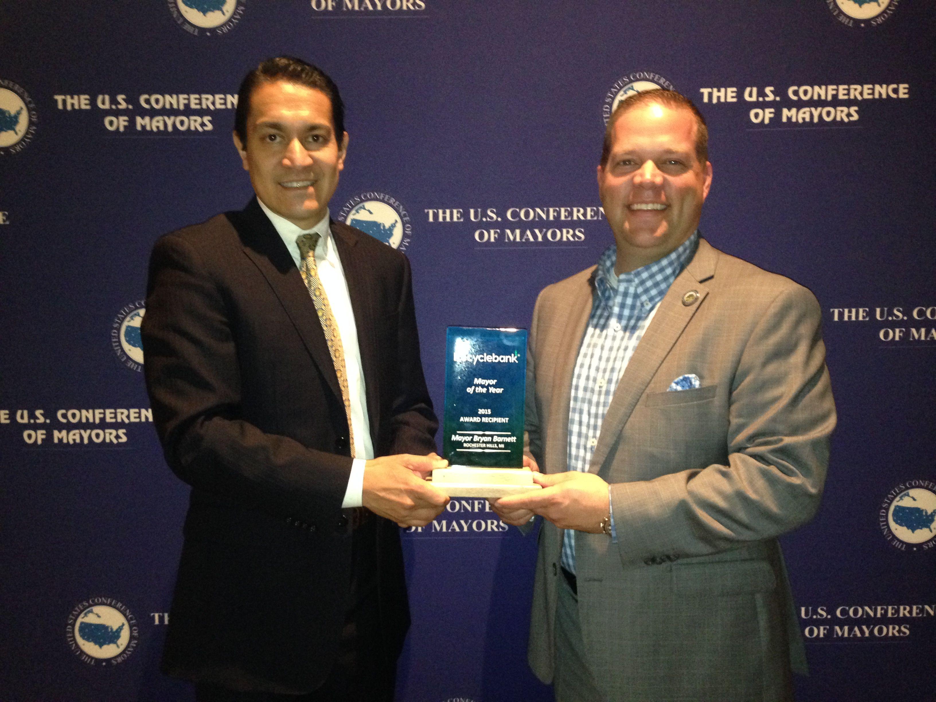 "Recyclebank CEO Javier Flaim (L) presents ""Mayor of the Year"" award to Mayor Bryan Barnett of Rochester Hills, MI"