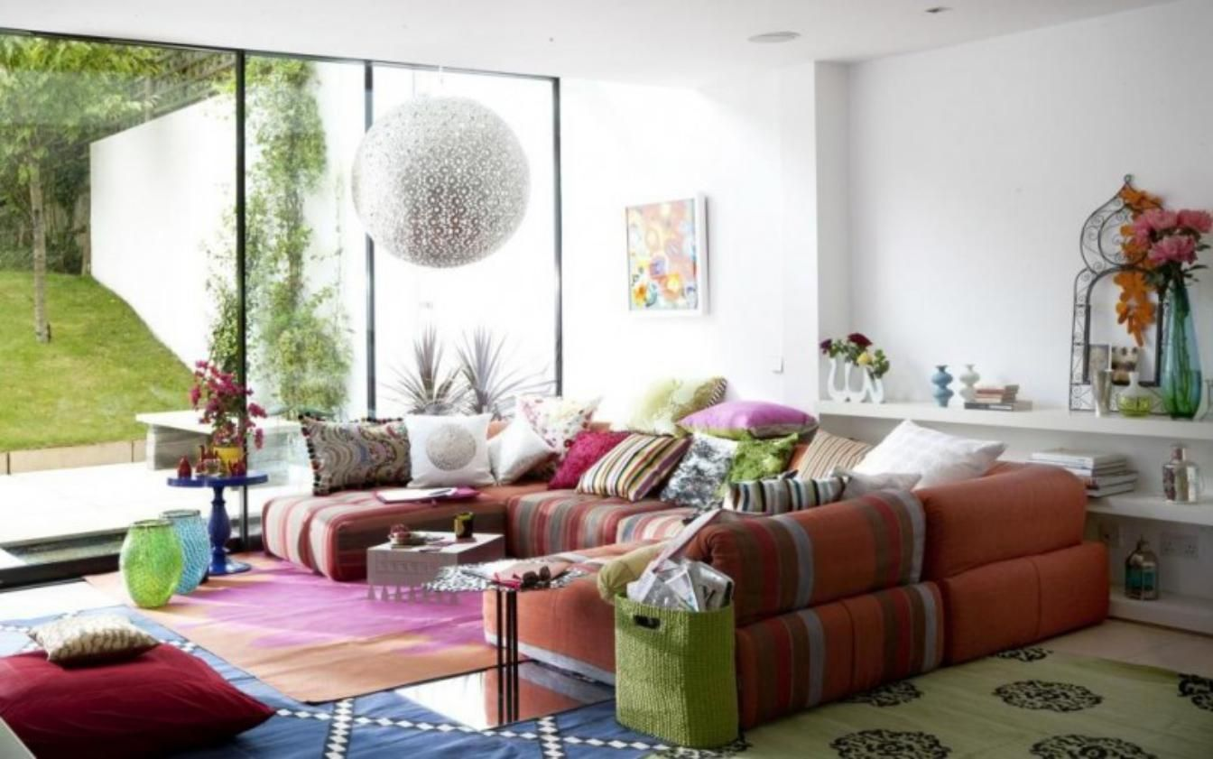 fancy living room with bright color furniture also wide glass window ...