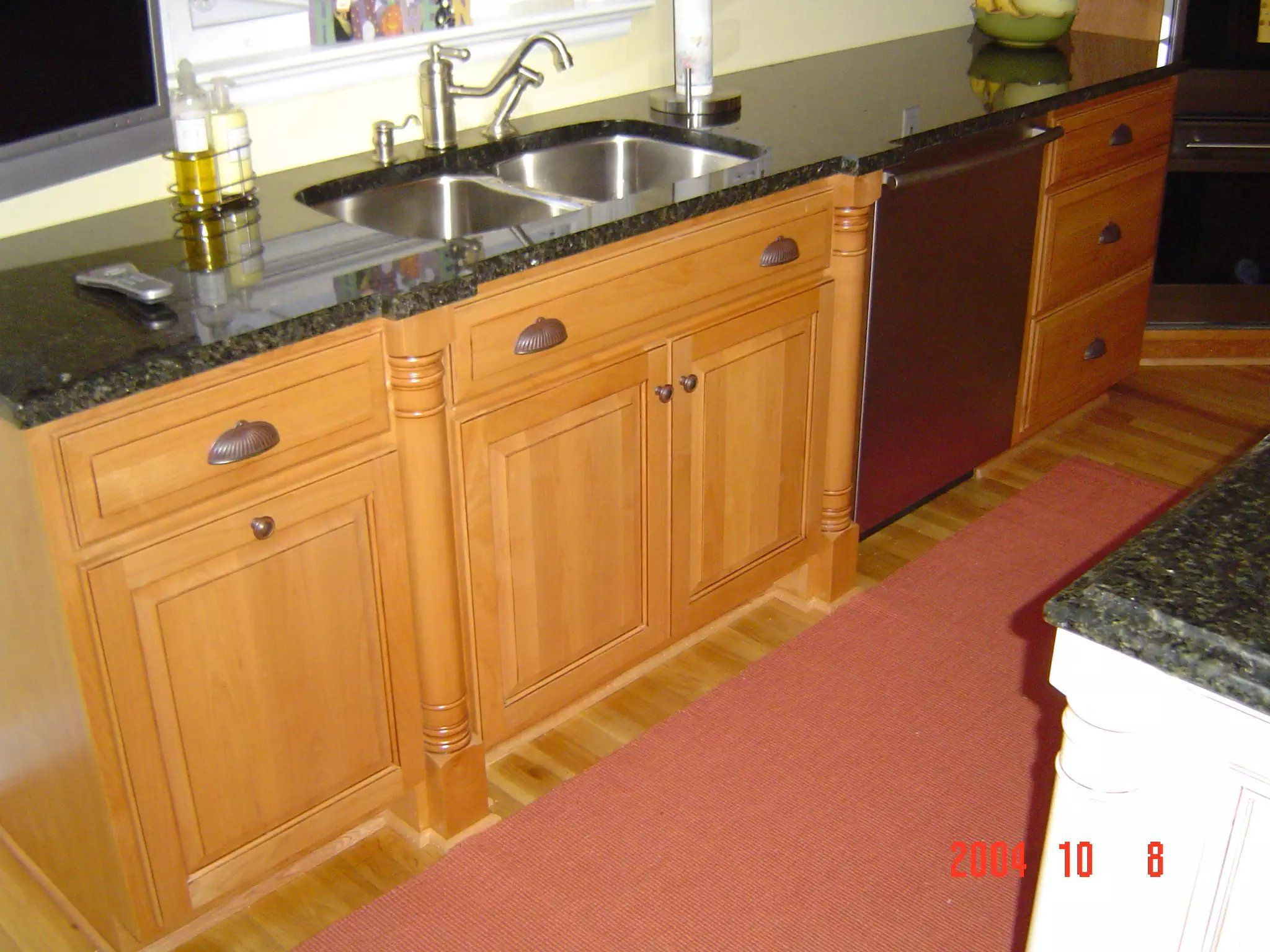 Custom Kitchen Sink By Prestige Cabinets Light Stained Wood With Black Countertops And Stai Stained Kitchen Cabinets Cabinets And Countertops Custom Cabinetry