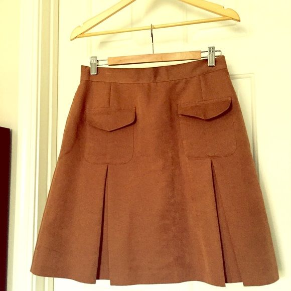 Beautiful camel a-line skirt Really cute a-line skirt with two front pockets and a zipper in the back. 70% rayon 30% polyester. Vintage item, says size 12 but fits like a 10. Length of skirt 21 inches. 30 inch waist. Last pictures for styling purposes only - not the actual skirt. Newport News Skirts A-Line or Full
