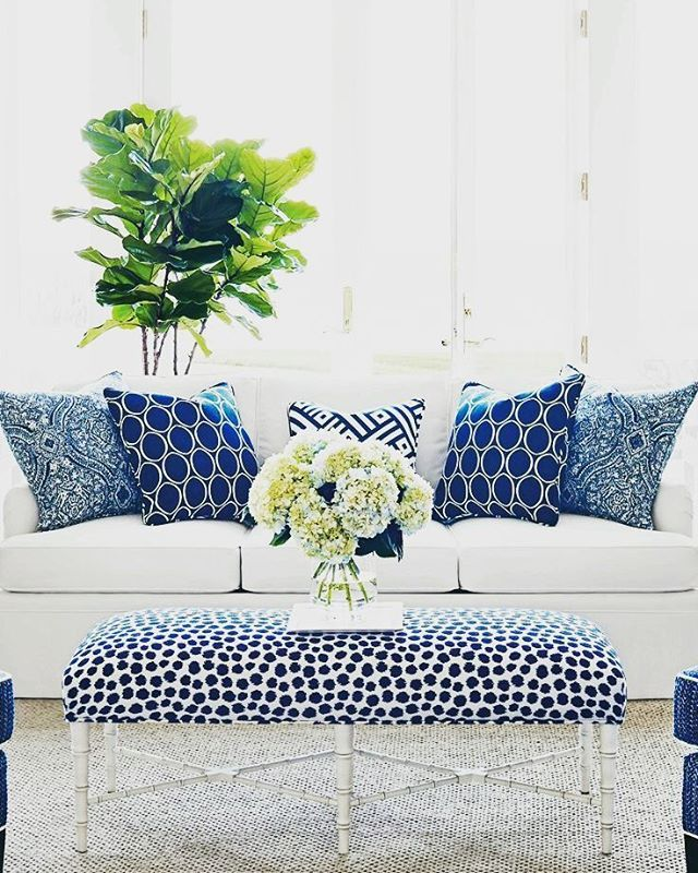 Bright White Sofa With Striking Patterned Throw Pillows In Blue Padded Ottoman Coordinating Pattern