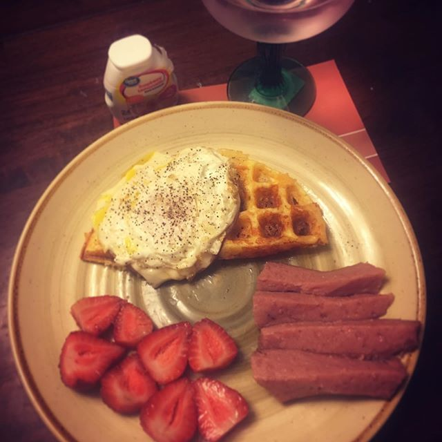 Ham egg and cheese chaffle with sausage and strawberries. Drink is raspberry lemonade. -A  Ham egg and cheese chaffle with sausage and strawberries. Drink is raspberry lemonade. -A . . . . .