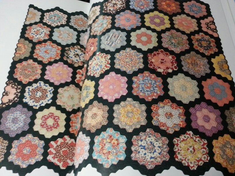 Example of depression era Grandmother's Flower Garden quilt with use of black.