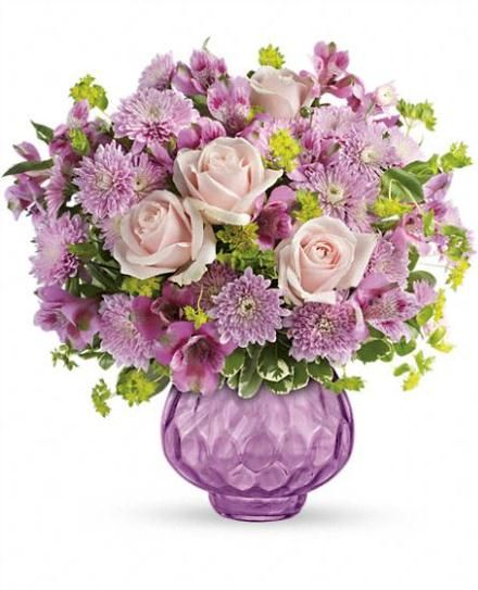 Like fine chiffon, this luxurious lavender bouquet is fabulously feminine and delightfully delicate. She'll love the beautiful blooms today, the brilliant gem votive vase tomorrow, and you - forever!