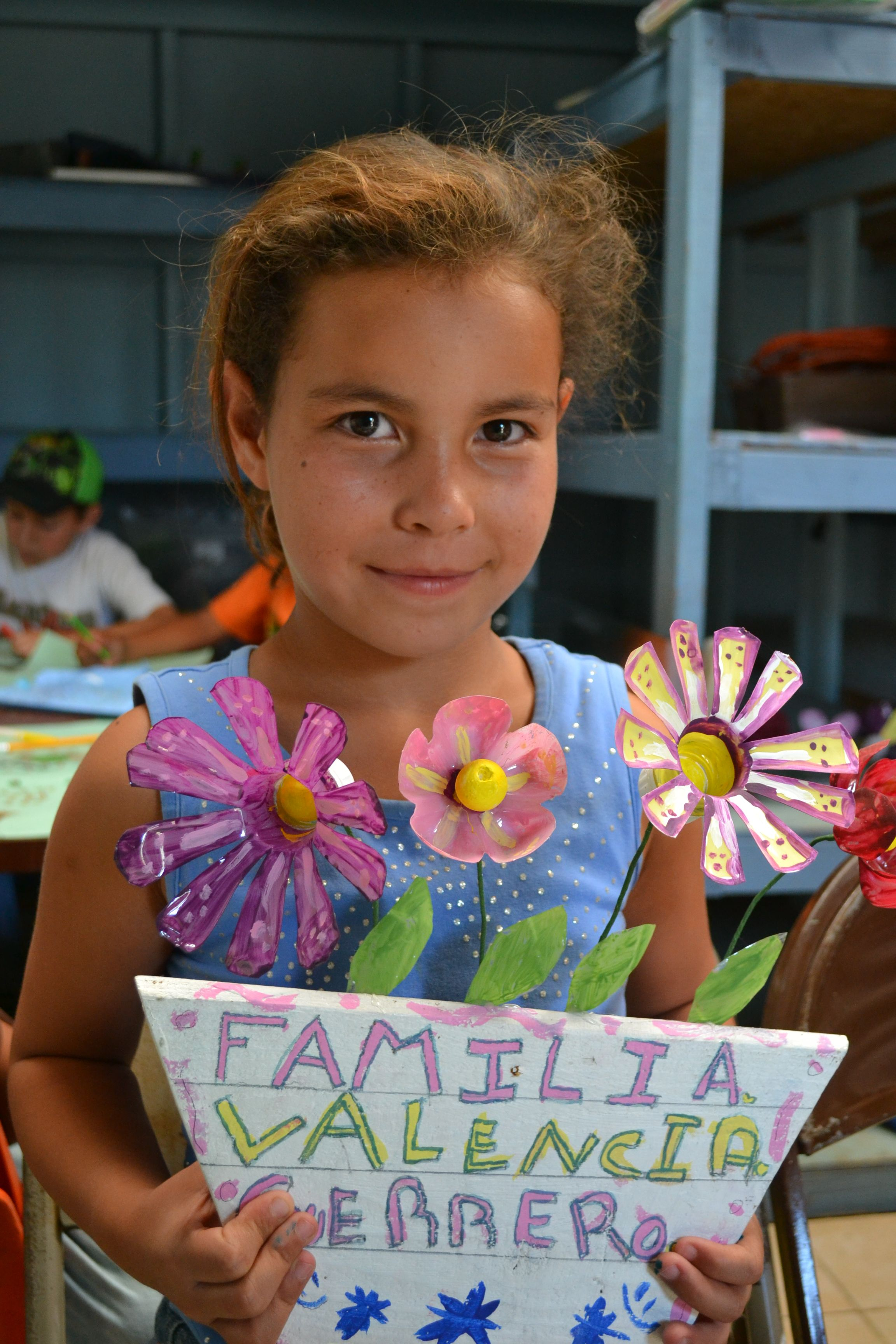 Very cute flowers made from recyclable materials! Corazon teaches our young participants to think green. #nonprofit #charity #corazon