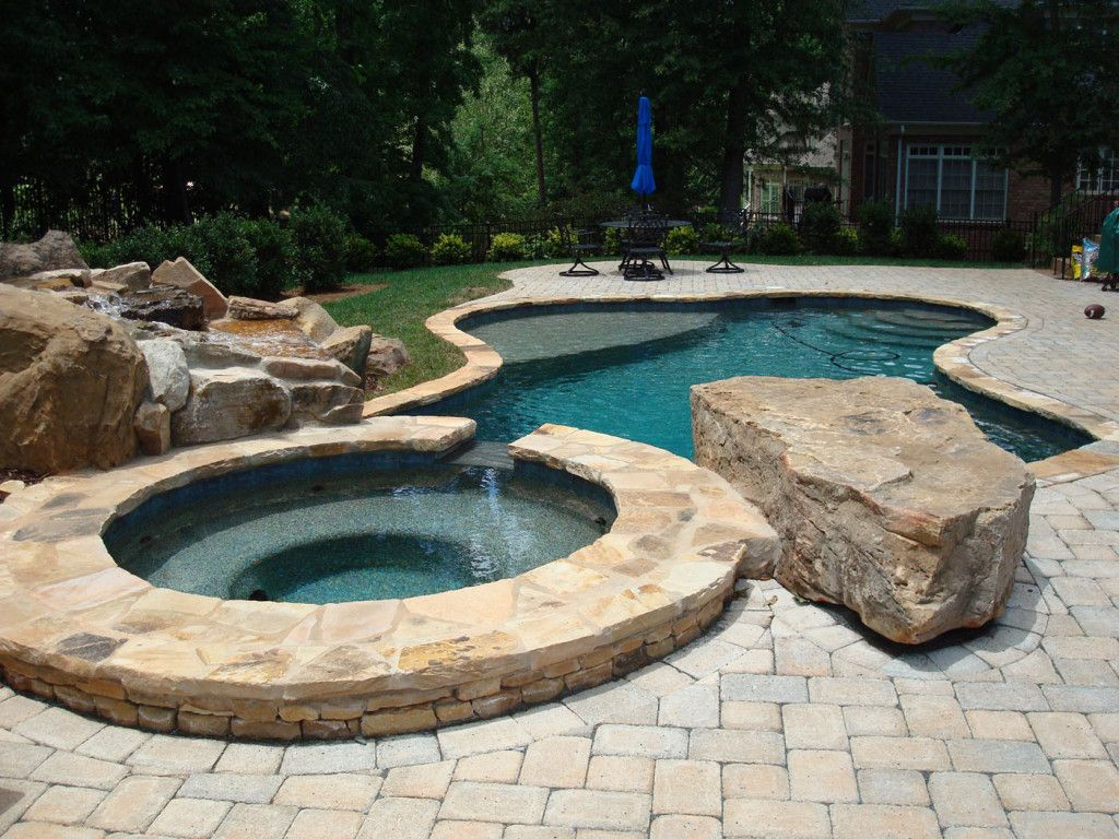 Custom pool decking and freeform pool pool retrofit for Custom swimming pools