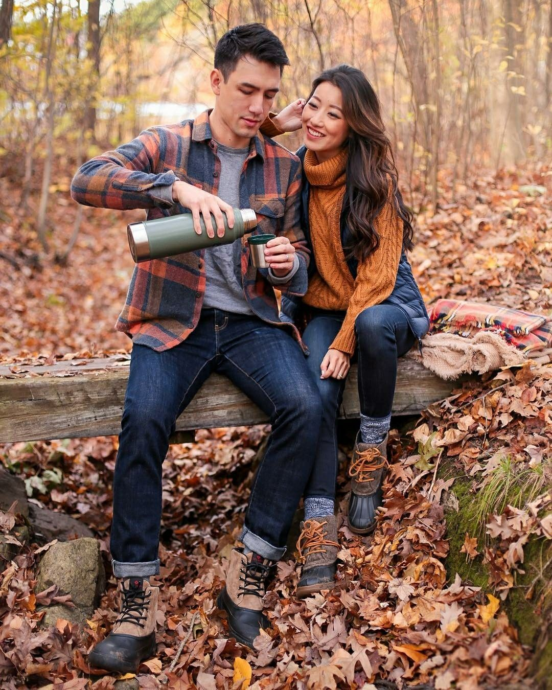 Plaid shirt, coordinating solid colored sweater, blue jeans, hiking boots. Great for an outdoor hiking session!