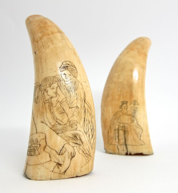 Scrimshaw, 19thc. A whale's tooth.  One tooth is decorated with a picture of Queen Victoria and the other shows a lady in 19thc dress. In simple terms, Scrimshaw generally describes the art of scratching, or inscribing of a design on a piece of ivory, bone, horn, shell, or antler, or many other natural materials, to produce decorative objects, jewellery, and useful items.
