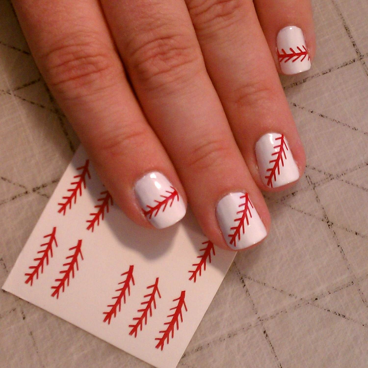 Baseball Thread Nail Art -- not a nail art fan but tons of sport stuff here  for those interested - Happy Opening Day! Here Are 10 Cute Baseball Nail Art Ideas Fans