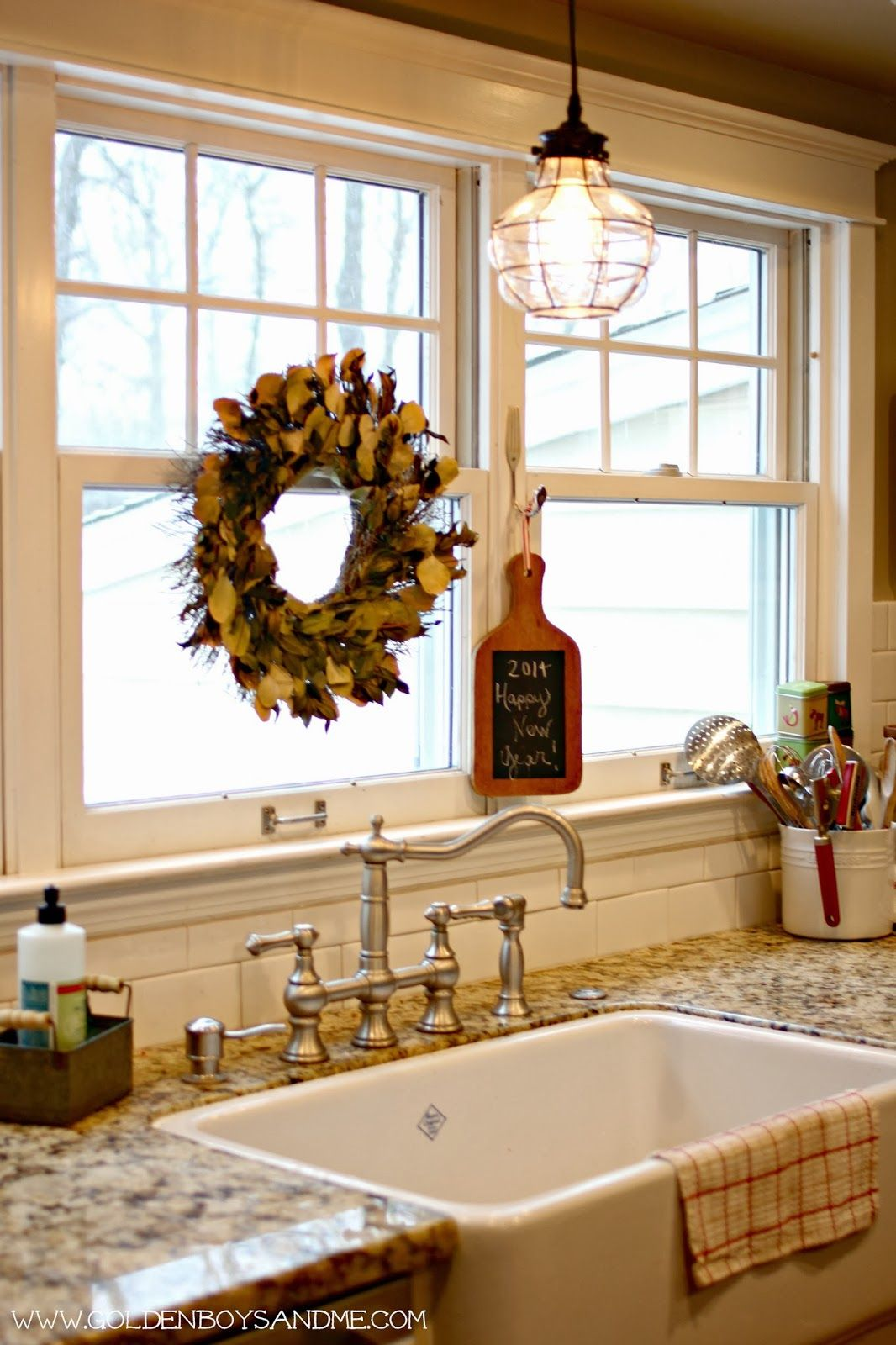 Winter In Our Kitchen Kitchen Sink Lighting Sink Lights Kitchen Sink Window Wall mounted light over kitchen sink
