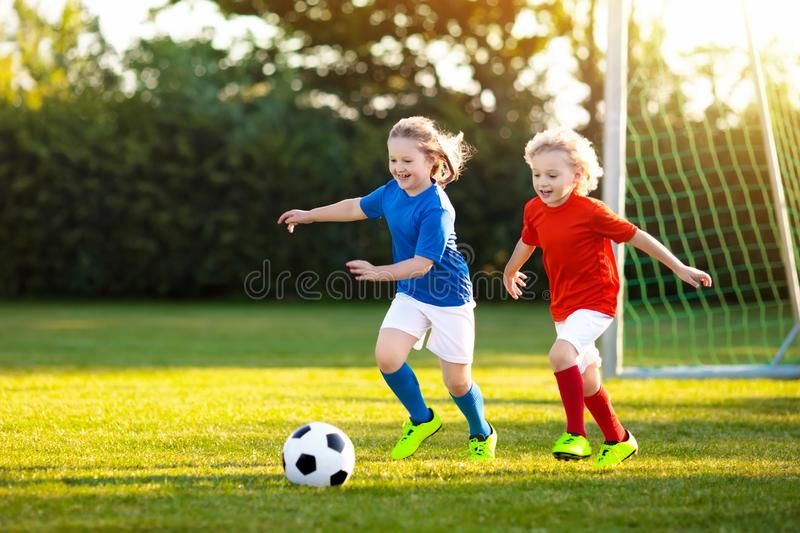 Kids Play Football Child At Soccer Field Kids Play Football On Outdoor Field Aff Field Soccer Children Outdoor Kids Playing Soccer Soccer Field