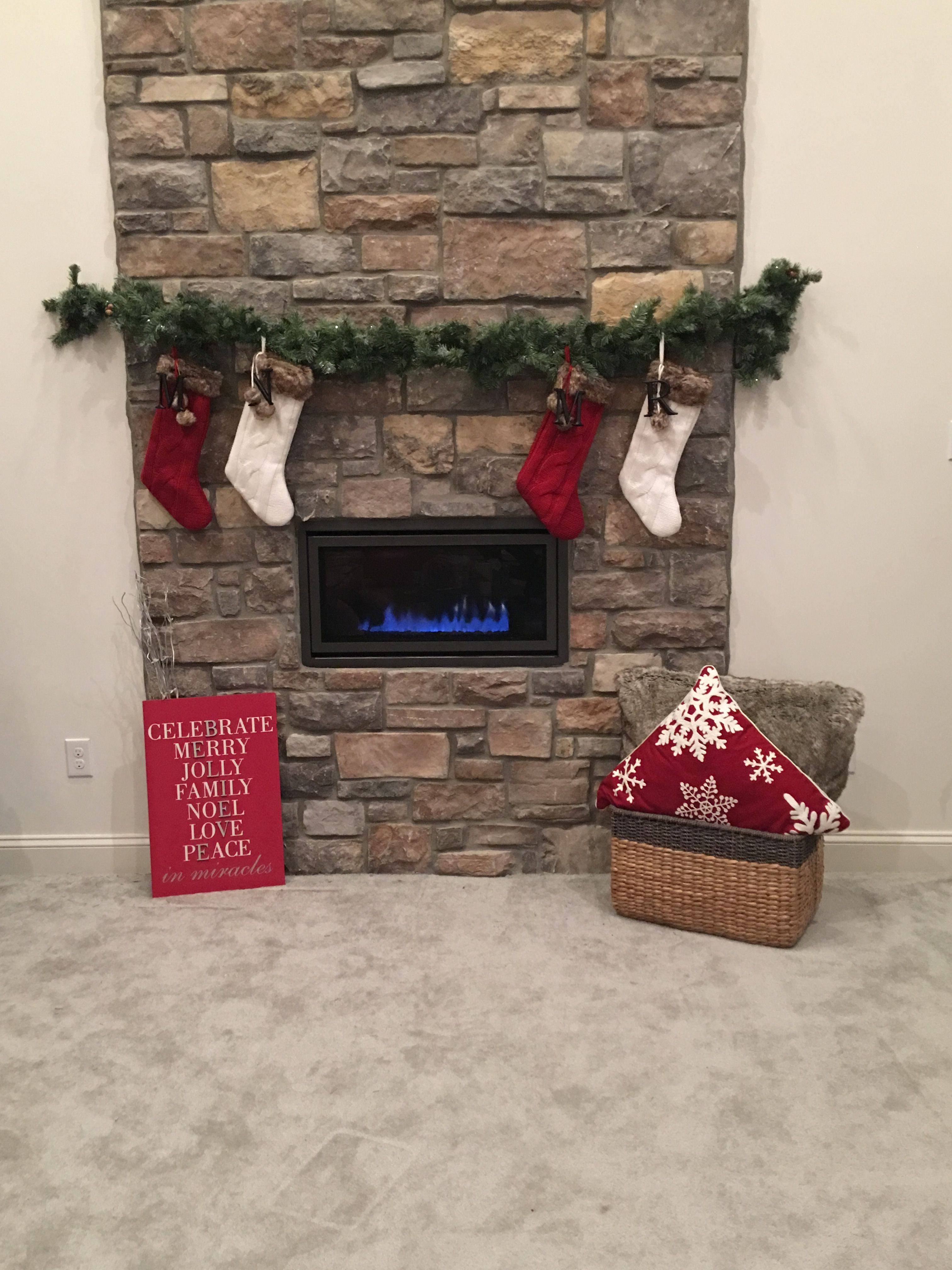 Creative Way To Hang Christmas Stockings Over A Modern Fireplace Without A Mantle Use A Hanging Christmas Stockings Christmas Fireplace Christmas Mantle Decor
