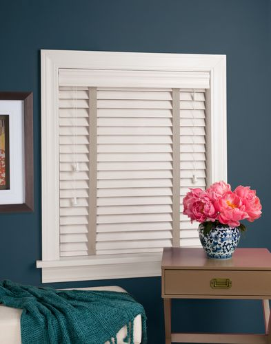 White faux wood EverWood blind with decorative tapes.
