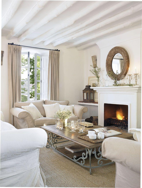 sal n blanco con vigas vista chimenea espejo redondo y mesa de centro de madera y forja299905. Black Bedroom Furniture Sets. Home Design Ideas
