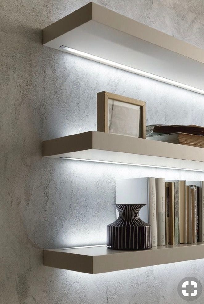 An Example Of How Strip Lights Can Be Used To Light Floating Shelves