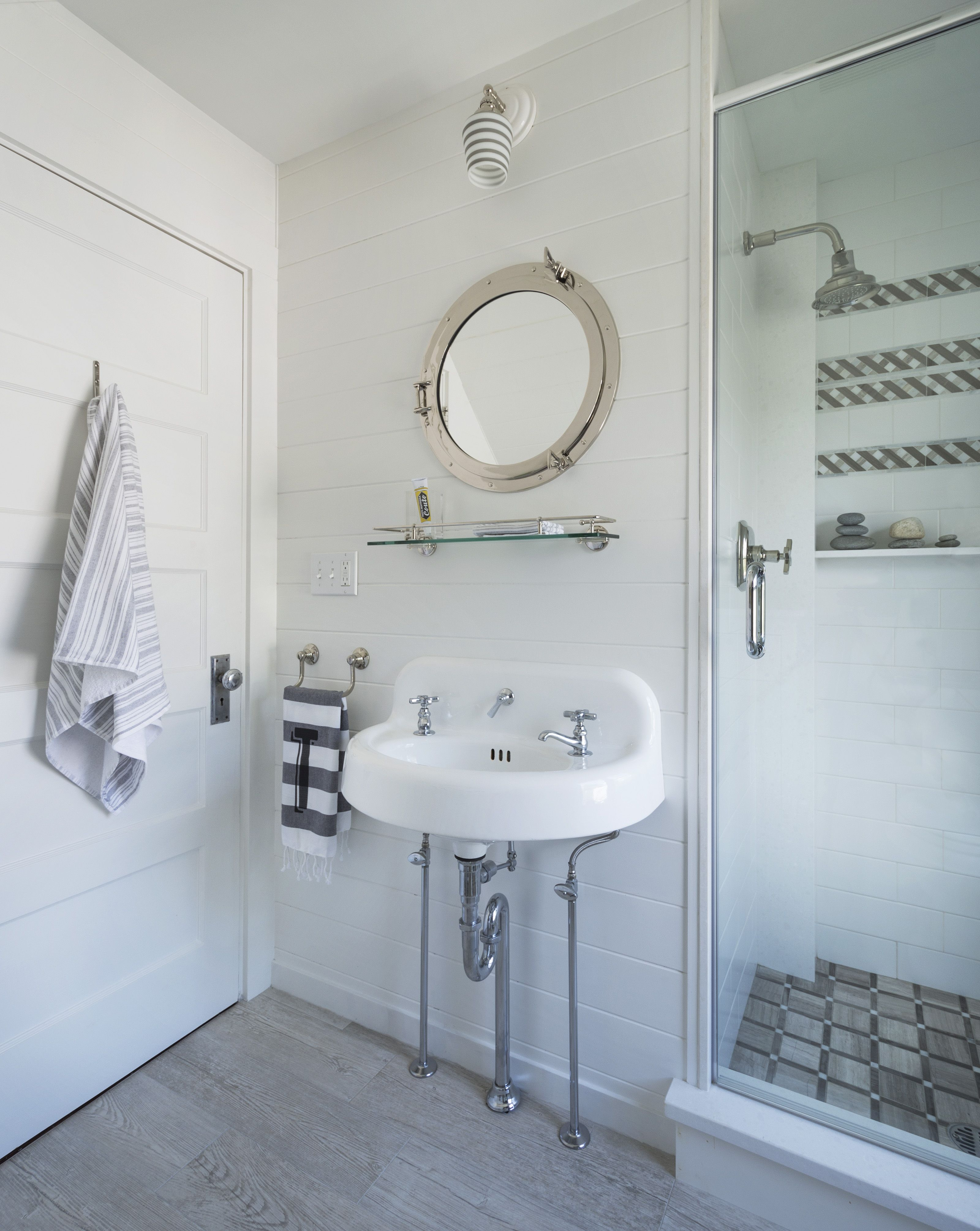 White wainscoting bath with vintage sink and porthole mirror ...