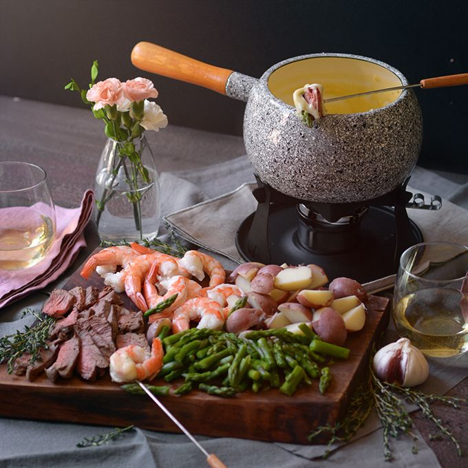 Want to add some romance to your dinner table? This Surf and Turf Cheese Fondue feast is the perfect rich and unique meal to share with someone special! #fondueparty
