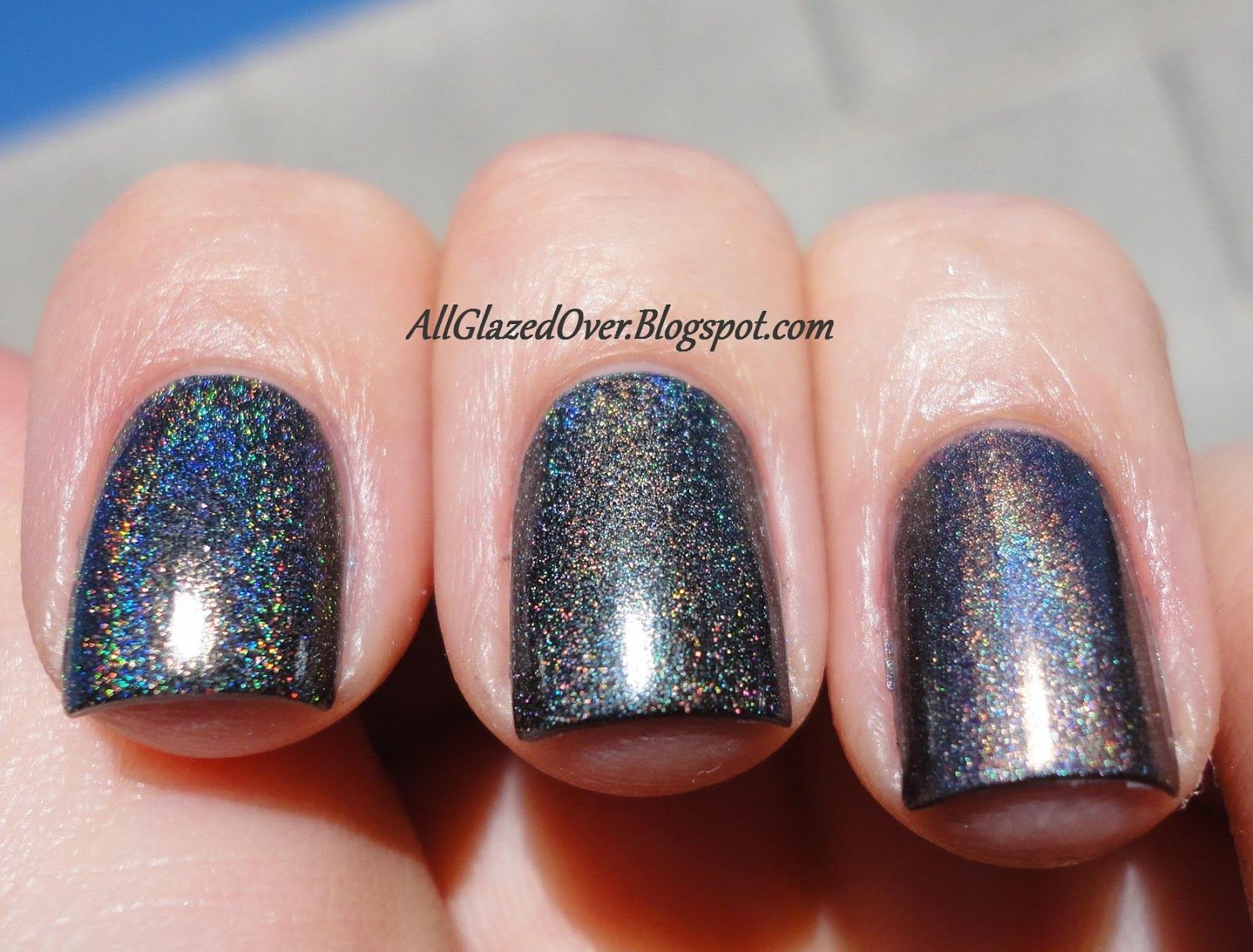Charcoal Gray holo comparison: L to R = Color Club Beyond (linear), Color Club Revvvolution (scattered)  and China Glaze Galactic Gray (linear)