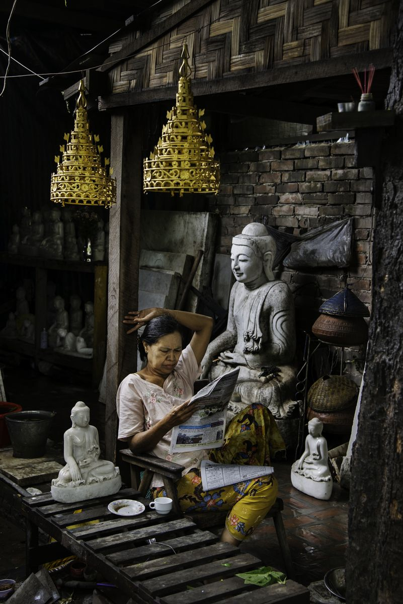 A woman reads in her shop in Yangon, Burma  We invite you to