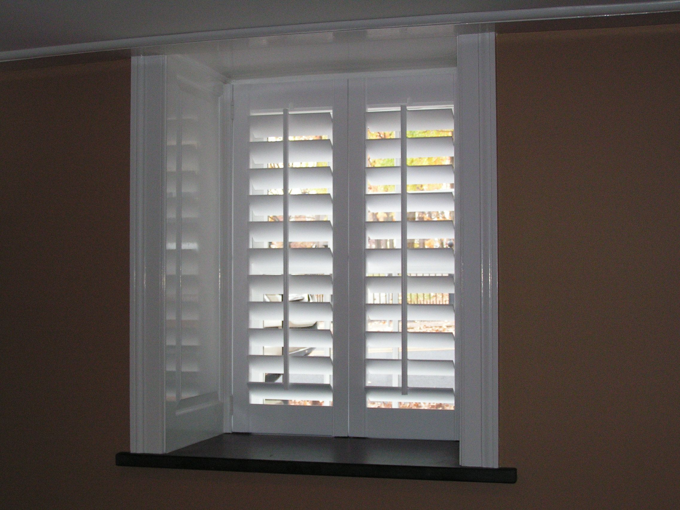 This Is In A Finished Basement Love The Deep Window Sills White Really Brightens The Space Window Styles Sliding Glass Door Shutters