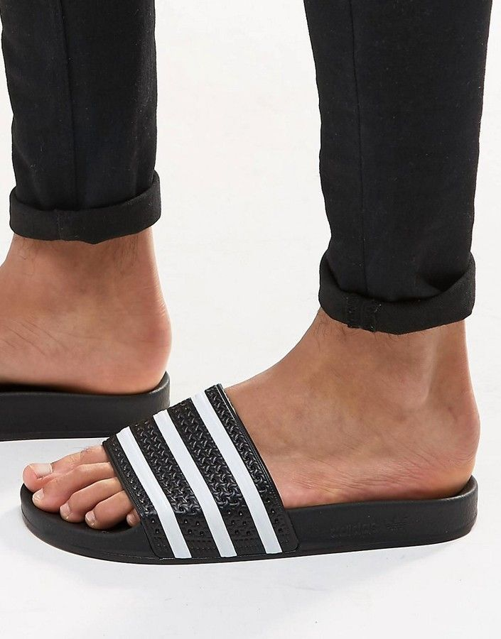 outlet store 06c0d e1853 adidas Adilette Sliders In Black 280647