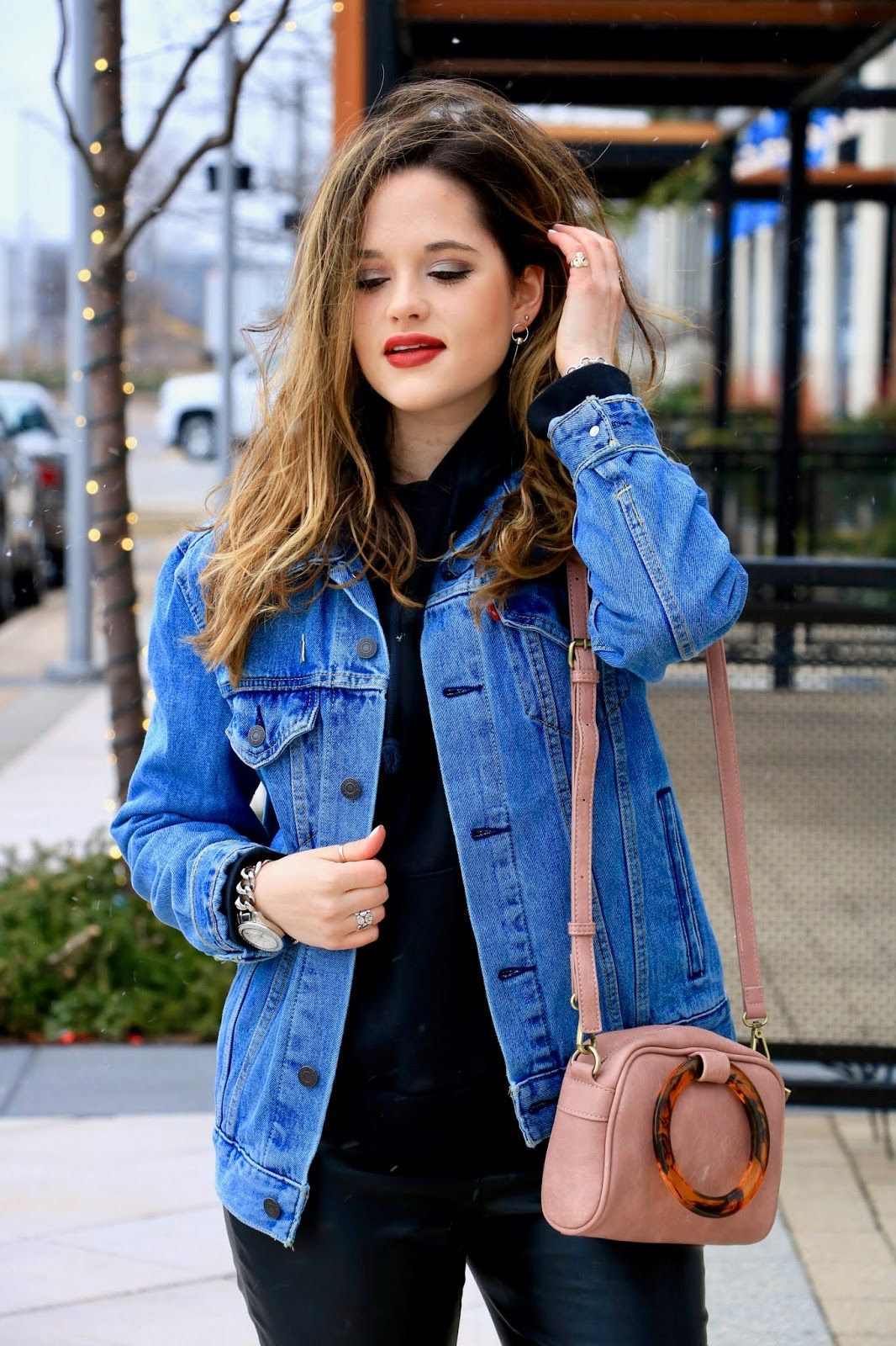 e3ac47b954 Layer a denim jacket over a hoodie.  OutfitIdea