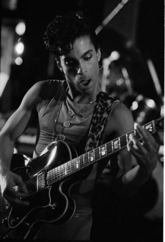 Prince Playing the Guitar by Nikki319Camille, via Flickr