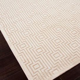 Art silk and chenille rug with a tribal geometric motif.    Product: RugConstruction Material: Viscose and chenilleColor: IvoryFeatures:  TuftedLustrous finishModern geometric pattern Note: Please be aware that actual colors may vary from those shown on your screen. Accent rugs may also not show the entire pattern that the corresponding area rugs have.Cleaning and Care: Vacuum without beater bar. Spot clean using mild detergent. Avoid direct sunlight to prevent fading.