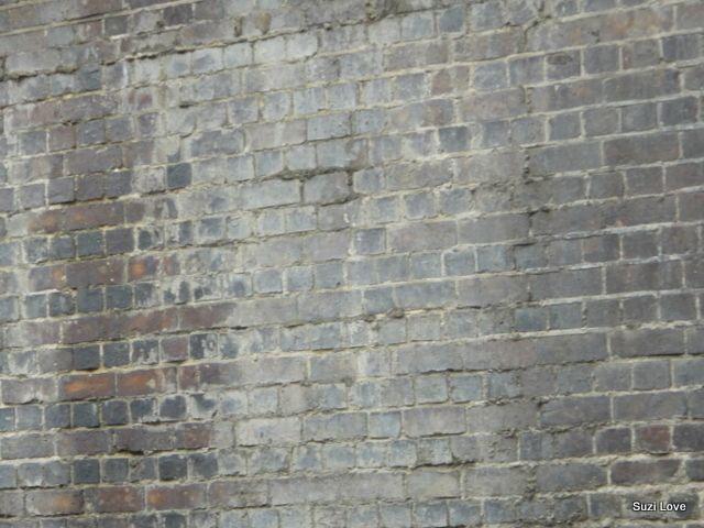 Original Brick Walls built beside the canals in London.  via suzilove.com
