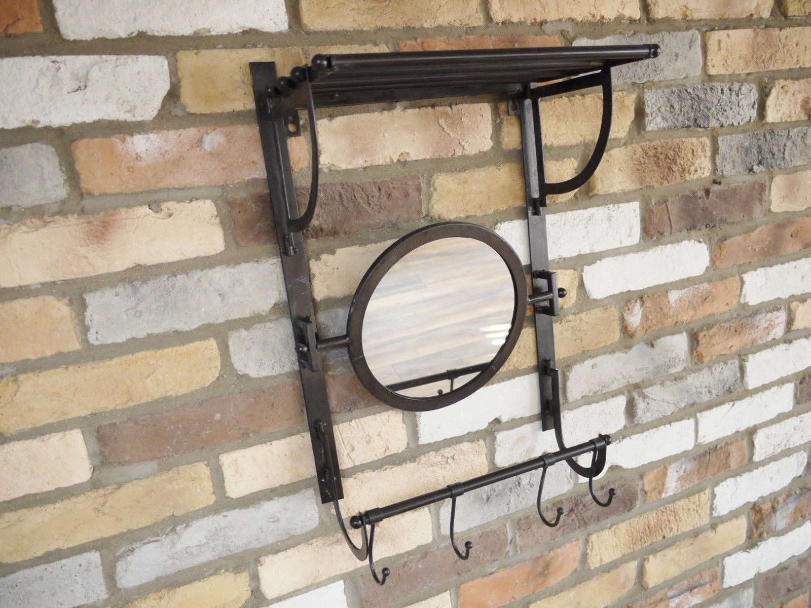 Black metal industrial shelf unit with mirror and hooks for hallway