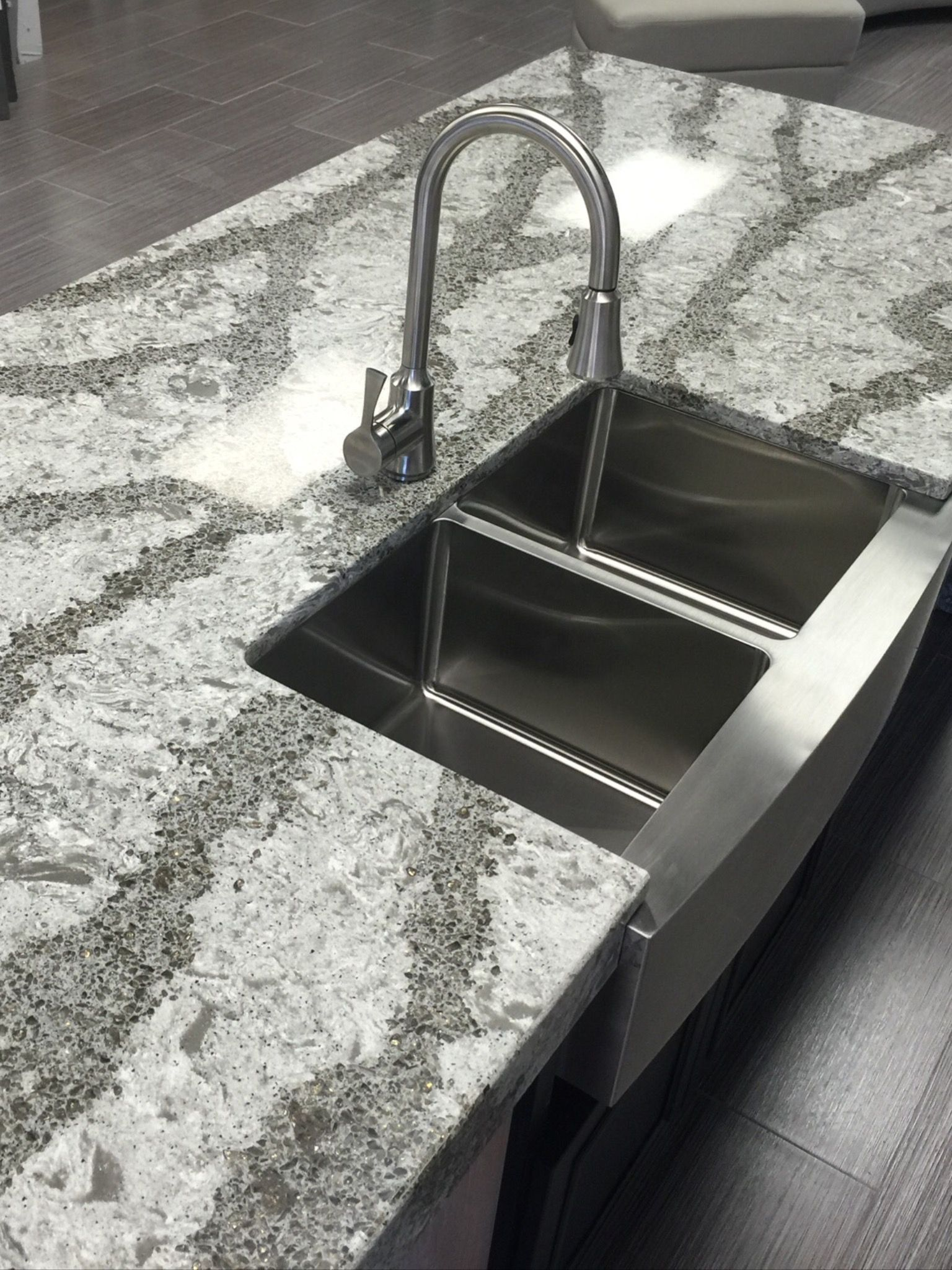 Cambria Galloway quartz island with farmhouse apron sink and single ...