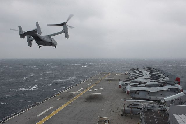 An MV-22 Osprey tiltrotor aircraft assigned to Marine Medium Tiltrotor Squadron (VMM) 265 takes off from the amphibious assault ship USS Bonhomme Richard (LHD 6).  #USNavy