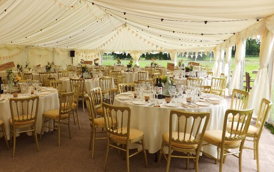 Elegant use of bunting and festoon lighting in a frame marquee ...