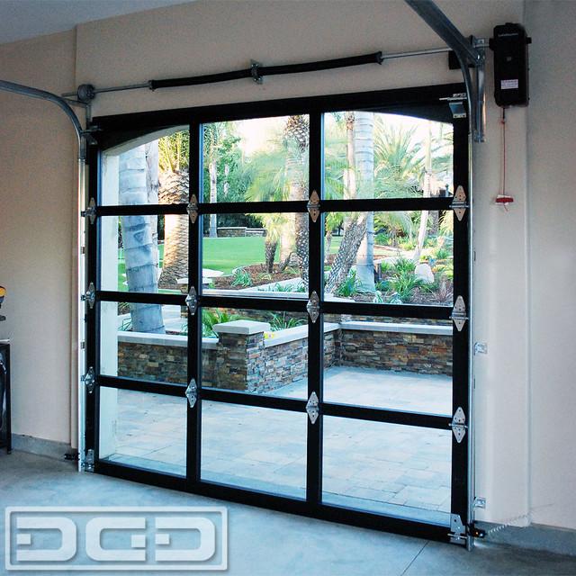 Full View Glass Metal Garage Doors For A Spanish Residence In La Habra Heights Eclectic Orange Cou In 2020 Metal Garage Doors Glass Garage Door Cost Garage Doors
